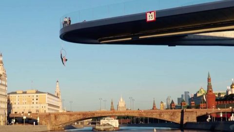 Russian Thrillseeker Hangs From Floating Bridge In Moscow Image