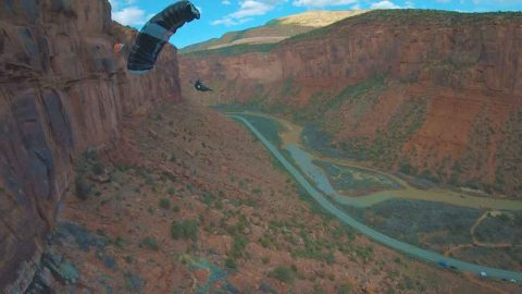 Drone Pilot Keeps Feet Safe On The Ground While Drone Takes To The Skies With Base Jumping Daredevils Image