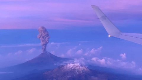 Stunning volcano explosion filmed from plane window Image