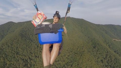 Shouldn't They Be Honey Nut? Peckish Paraglider Munches On Bowl Of Lucky Charms While Gliding Through Air Image