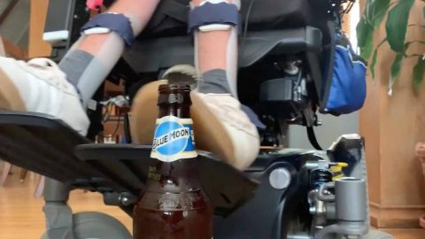 Man With Neuromuscular Disease Pulls Off Bottle Cap Challenge While On Wheels Image