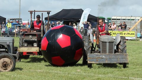 TRACTORBALL – FARMERS MAKE THE MOST OF THEIR OLD TRACTORS BY USING THEM FOR A GAME OF FOOTBALL Image