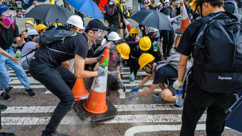 VIDEO FROM INSIDE HONG KONG PROTEST SHOWS HOW PROTESTORS DEAL WITH TEAR GAS BY COVERING CANNISTERS WITH CONES AND DOUSING THEM IN WATER Image