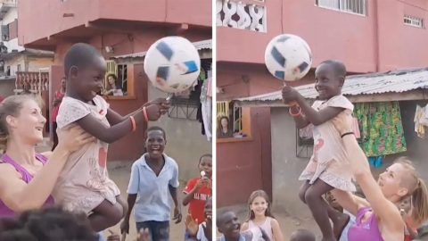 FREESTYLE FOOTBALLER BRINGS JOY TO CHILDREN BY INVOLVING THEM IN MESMERISING TRICK Image