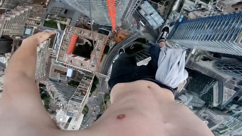 FROM PARIS ABOVE! TEEN DANGLES FROM CRANE ONE-HANDED – 650 FEET ABOVE FRENCH CAPITAL Image