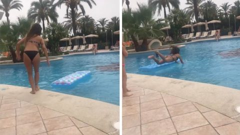 GIRL TRIES TO JUMP ONTO LILO BUT THE WIND SWEPT AWAY THE RAFT LEAVING HER TO FACE-PLANT IN THE POOL Image