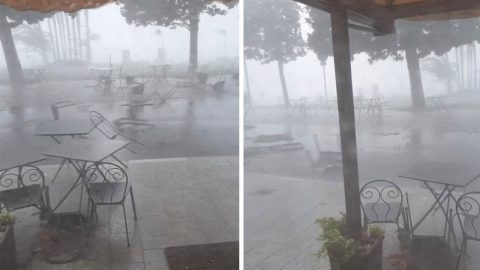 TERRIFYING MOMENT VIOLENT STORM SWIPES RESTAURANTS' CHAIRS AND TABLES ACROSS STREET Image