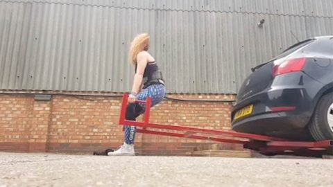 SLENDER DISABILITY NURSE BECOMES ENGLAND'S STRONGEST WOMAN USING UNIQUE TRAINING METHODS LIKE LIFTING VAUXHALL CORSA Image