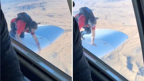 DAREDEVIL CLIMBS OUT ON TO PLANE WING AND HANGS ON BEFORE BACKFLIPPING INTO THE AIR Image