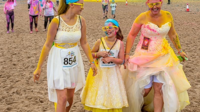 WEDDING REHASHER! MUM SO DESPERATE TO REWEAR HER WEDDING DRESS SHE COMPLETED 3KM COLOUR RUN IN IT - AND NOW PLANS TO HANG DESTROYED GOWN IN HOME Image