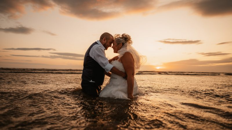 HOL-SEA MATRIMONY! BRIDE TRASHES £999 WEDDING DRESS BY JUMPING INTO CRASHING WAVES Image