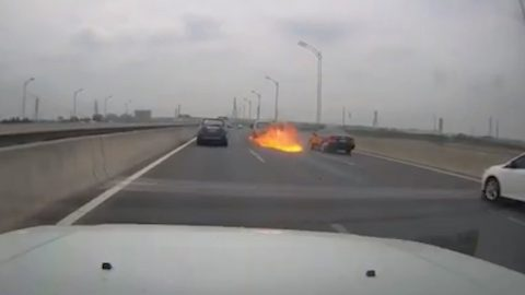 IS THAT YOU DOC? CAR LEAVES TRAIL OF FLAMES IN ITS WAKE AS IT SPEEDS DOWN HIGHWAY Image
