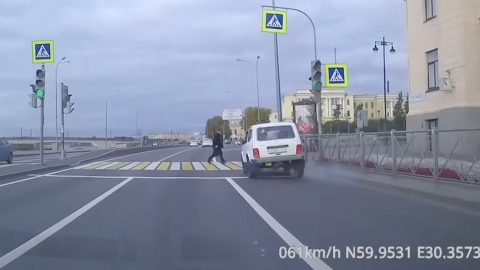 HIGH SPEED CAR PLOUGHS INTO PEDESTRIAN BUT THE IMPACT KNOCKS IT OVER TOO Image
