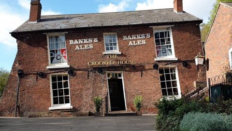 A PUB AS DRUNK AS ITS CUSTOMERS! MARBLES ROLL UPHILL AT BIZARRE 'CROOKED HOUSE' BOOZER Image