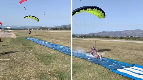 SKYDIVE SLIP 'N' SLIDE! THIS SKYDIVER LANDS ON A SLIP AND SLIDE FOR A HILARIOUS LANDING Image