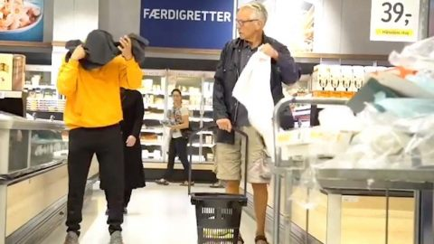 YOU CAN'T PULL THE TOWEL OVER MY EYES: PRANKSTER THROWS TOWELS OVER THE HEADS OF UNSUSPECTING SHOPPERS IN HILARIOUS VIDEO Image