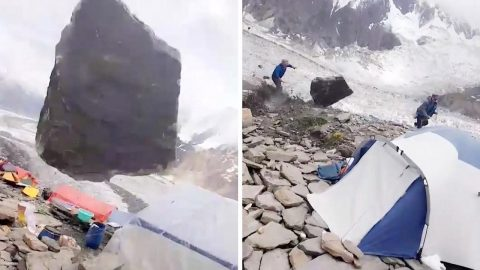 ROCKY ESCAPE! A LOOSE BOULDER FLIES DOWN MOUNTAIN NARROWLY MISSING HIKERS IN THE PROCESS Image