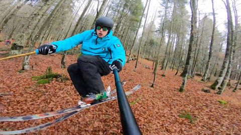 THE LACK OF SNOW DOES NOT STOP THIS SKIER AS HE GLIDES ACROSS THE FRESHLY FALLEN AUTUMN LEAVES Image