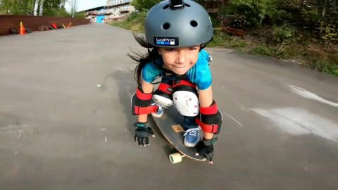 SIX-YEAR-OLD SNOWBOARDER WITH NATIONAL RECORDS SHOWS SHE'S JUST AS AMAZING ON DOWNHILL SKATEBOARD Image
