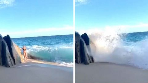 MODEL POSING ON BEACH WIPED OUT BY POWERFUL WAVE Image