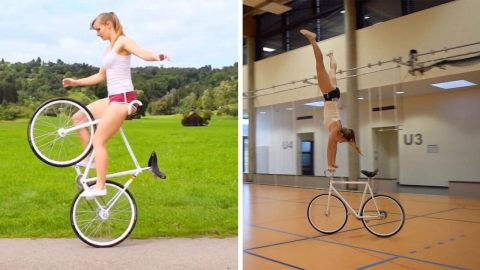 FLEXIBLE CYCLIST PERFORMS WHEELIE AMAZING TRICKS WHILE RIDING HER BIKE Image