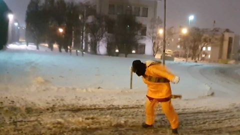WINDS FROM ICELANDIC BOMB CYCLONE PUSH PEDESTRIANS BACKWARDS ALONG PAVEMENT Image