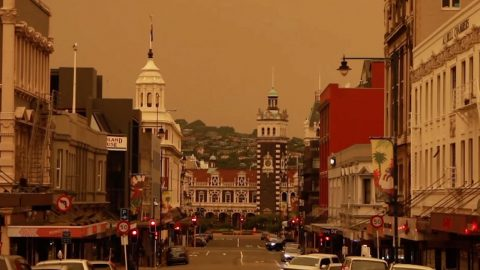 HAUNTING SCENES SHOW NEW ZEALAND CITY BLANKETED BY THICK ORANGE SMOKE AND ASH FROM DEADLY AUSTRALIAN BUSHFIRES RAGING OVER 1,200 MILES AWAY Image