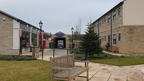 TAKE A WALK DOWN MEMORY LANE AT THIS CARE HOME THAT HAS BUILT A 1950S CORONATION STREET PARADE OF SHOPS FOR RESIDENTS WITH DEMENTIA Image