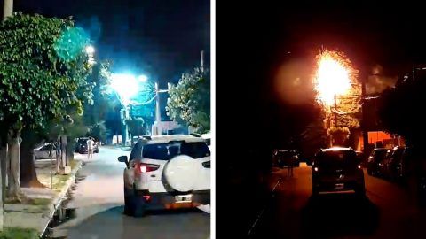 ELECTRICITY TRANSFORMER LIGHTS UP NIGHT SKY AS IT EXPLODES ABOVE STREET Image