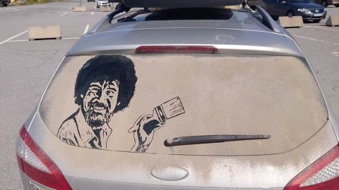 ARTIST CHANNELS HIS INNER BOB ROSS WHEN CREATING INNOVATIVE DUST ART ON THE BACK OF DIRTY CAR WINDOW Image