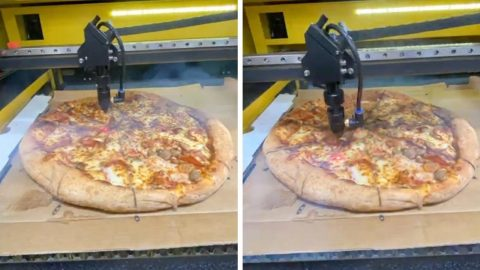 HUNGRY EXTERMINATOR CUTS PIZZA WITH 60 WATT LASER IN FUTURISTIC VIDEO Image