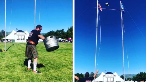 KILT-WEARING ATHLETE FILMED HURLING HEAVY KEG AN INCREDIBLE 35 FEET IN THE AIR Image