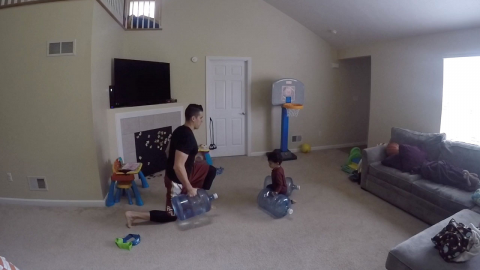 SON WORKS OUT WITH HIS DAD IN ADORABLE VIDEO Image
