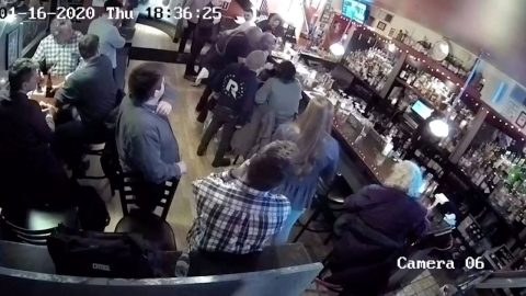 THIS IS NOT A CHOKE! BARMAN RUNS TO THE RESCUE AS MAN CHOKES IN FRONT OF HIM AND PERFORMS HEIMLICH MANOEUVRE TO SAVE HIM Image