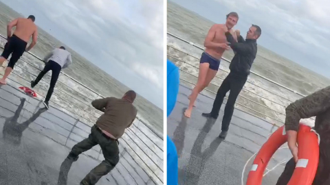 DRAMATIC MOMENT MAN RESCUED FROM FREEZING STORMY SEA Image