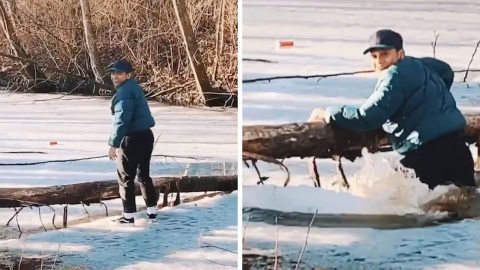 ICY ERROR! MAN TRIES TO STAND ON FROZEN LAKE AND FALLS STRAIGHT INTO THE WATER Image