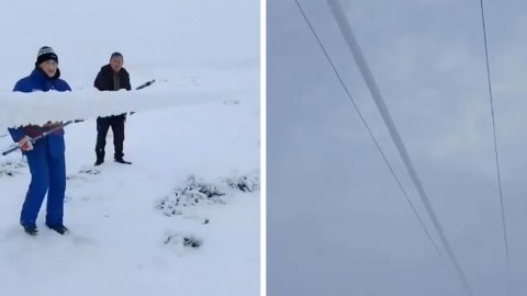 MAINTENANCE WORKERS REMOVE ICE FROM HIGH VOLTAGE WIRE IN SATISFYING VIDEO Image
