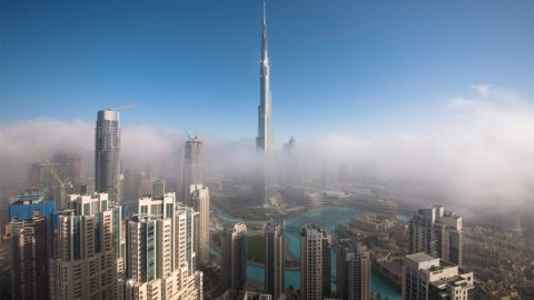 DUBAI IN THE SKY! RARE PHENOMENON TRANSFORMS ICONIC DUBAI SKYLINE INTO BLANKET OF FOG – LEAVING THE BURJ KHALIFA LOOKING LIKE A SPACE ROCKET Image