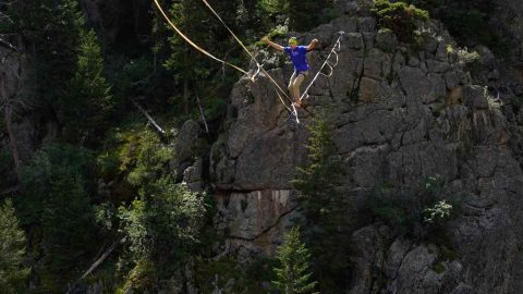 THIS ADRENALINE JUNKIE IS LIVING THE HIGHLINE AS HE PERFORMS HEART-RACING TRICKS ON PRECARIOUS TIGHTROPE Image