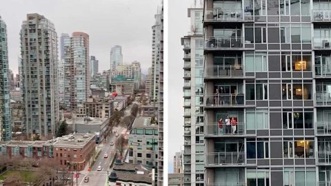 PEOPLE OF VANCOUVER STEP OUT ONTO THEIR BALCONIES TO GIVE A RAPTUROUS APPLAUSE FOR THE HEALTH WORKERS BATTLING COVID-19 Image