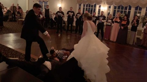 WRESTLING-THEMED WEDDING ENTRANCE ENDS WITH GROOM THROWING RIVAL THROUGH TABLE Image