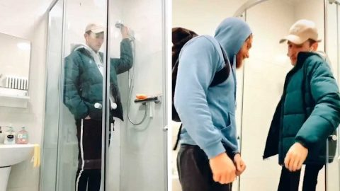 LONDONER RE-ENACTS TUBE COMMUTE USING SHOWER CUBICLE DURING QUARANTINE Image