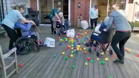 ELDERLY RESIDENTS PLAY HUNGRY HIPPO GAME DURING COVID-19 LOCKDOWN USING WASHING BASKETS TO CURE BOREDOM Image