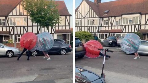 NEIGHBOURS BATTLE IT OUT IN THE STREET IN COMICAL INFLATABLE BALLS Image