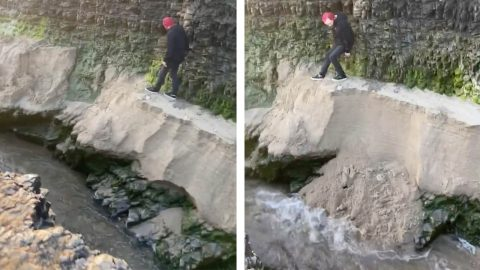CLOSE CALL AS THIS LAD NEARLY FALLS INTO WATER AFTER GROUND GIVES WAY Image