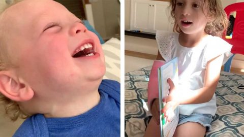 LITTLE GIRL MAKES BROTHER LAUGH BY SNAPPING BOOK SHUT Image