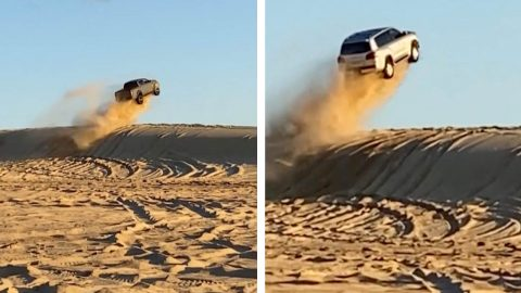 JUMPING OVER A SAND DUNE IN A TRUCK Image