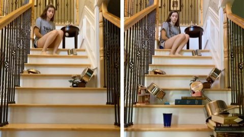 WOMAN SPENDS HOURS PERFECTING PING-PONG TRICK-SHOT ON STAIRCASE Image