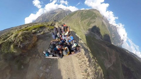INTENSE MOMENT TOURIST TRUCK TAKES TINY ROAD UP MOUNTAIN Image