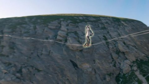 ADRENALINE-FILLED DRONE FOOTAGE CIRCLES AROUND SLACKLINERS ABOVE A FRENCH VALLEY Image
